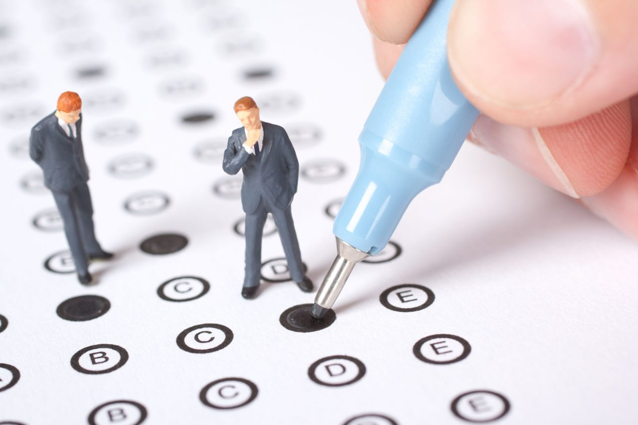 15554572 - student complete the questionnaire - school exam concept.